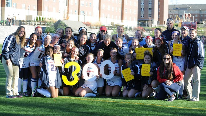 Shippensburg University's field hockey team celebrates coach Bertie Landes' 300th win with the program after defeating East Stroudsburg, 2-1, on Saturday afternoon in the NCAA Division II quarterfinals.