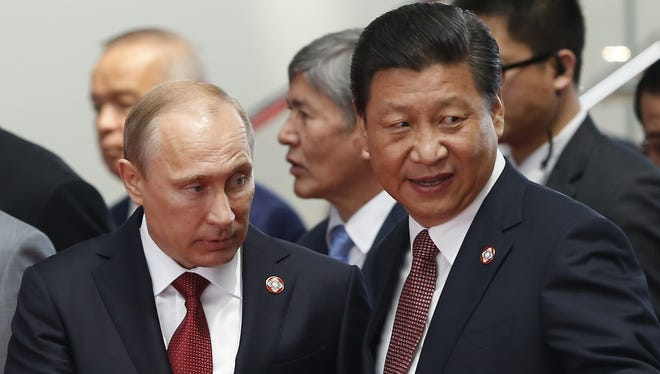 Russian President Vladimir Putin, left, and Chinese President Xi Jinping attend the fourth Conference on Interaction and Confidence Building Measures in Asia summit in Shanghai on Wednesday.