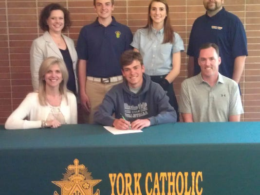 Pictured, from left in front row: Chris Stewart, mother, Robbie Stewart; Rob Stewart, father. Back row: Katie Seufert, York Catholic High School Principal; Joshua Stewart, brother, Natalie Stewart, sister, and Dan Mickle, Yorktowne Volleyball club director. (SUBMITTED)