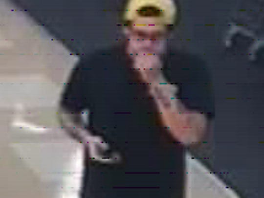Possible suspect in a check fraud investigation is seen in this surveillance camera image.