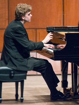 Reed Tetzloff performs in the semifinals of the 2014 World Piano Competition, being held at CCM.