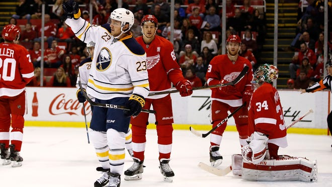 The Sabres' Sam Reinhart celebrates a goal while playing the Red Wings Tuesday at Joe Louis Arena.