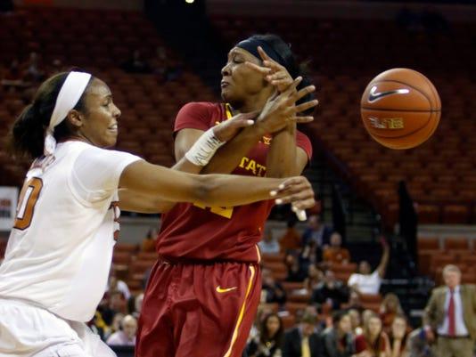 Texas guard Brianna Taylor, left, knocks the ball away from Iowa State guard Seanna Johnson during the first half of an NCAA college basketball game, Wednesday, Jan. 6, 2016, in Austin, Texas. (AP Photo/Michael Thomas)