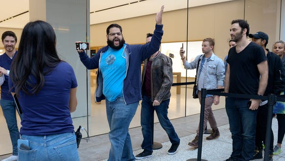 As the doors to the Apple Store open a man yells to