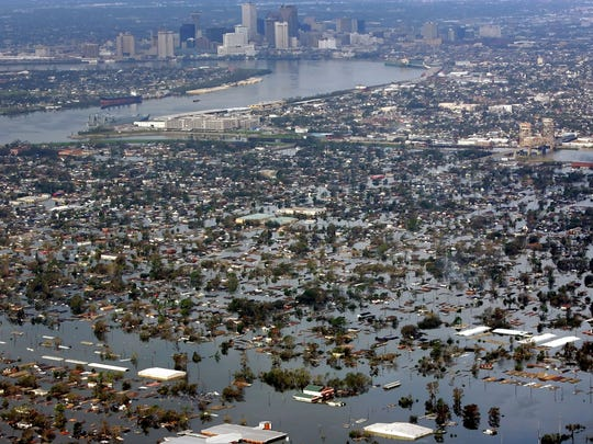 Katrina: On Aug. 30, 2005, floodwaters from Hurricane Katrina covered the Lower 9th Ward, foreground, and other parts of New Orleans, a day after the storm passed through the city.