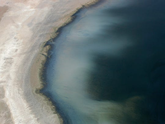 Seen from the air, the waters of the Salton Sea vary greatly in color from one place to the next, depending principally on suspended sentiments and algae in the water.
