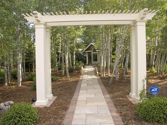 Here's a paver walkway and accent pergola.