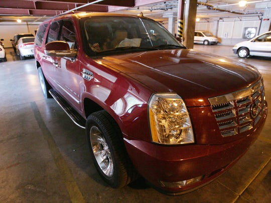 The Cadillac Escalade in which Warren Jeffs was riding when he was apprehended by the Nevada Highway Patrol and the FBI sits in the garage at the FBI offices in Las Vegas in 2006. Former Jeffs bodyguard Willie Jessop, now estranged from his former employer's church, was the high bidder for the Escalade on Monday. Jessop bid $30,000 for the vehicle and $50,000 for its contents, which at the time of the arrest included cash, gift cards, laptop computers and other personal items.