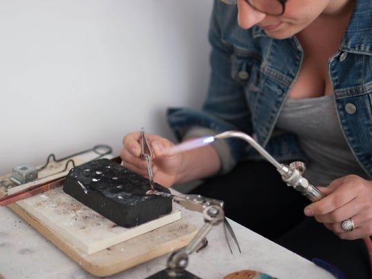 Cowan believes that having her workbench in her shop