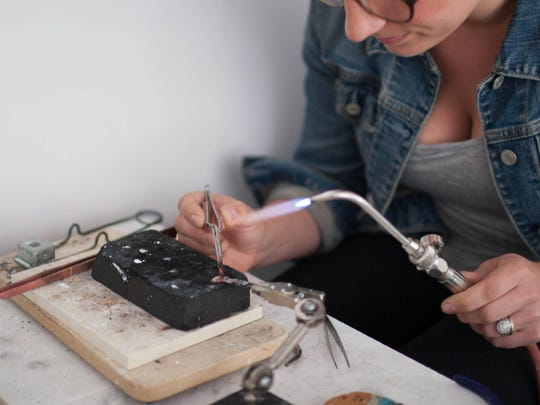 Cowan believes that having her workbench in her shop allows her customers a sought-after look into her craft.