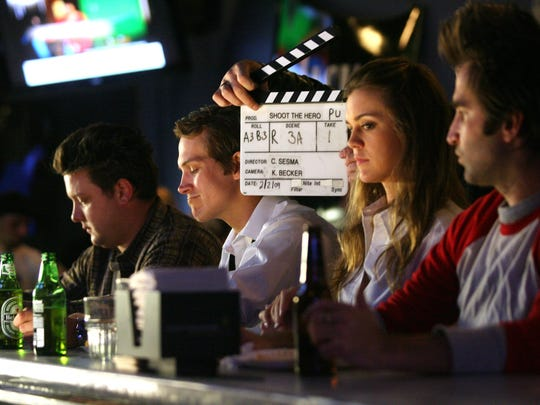 """Actors (from left) Nic Nac, Jason Mewes, Samantha Lockwood, and Mike Hatton wait for the cue to start as filming takes place at the bar at NYPD Pizza for the movie """"Shoot the Hero"""" directed and written by Christian Sesma on Feb. 2, 2009, in Palm Springs."""