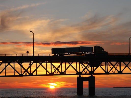 A semi crosses the Mackinaw Bridge as th