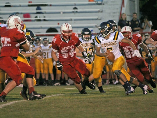 Bringman looks for yardage against the Port Clinton defense during the 2014 season.