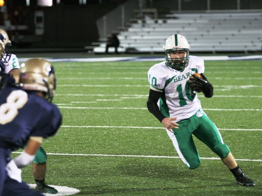 Margaretta's Tyler Henderson looks for room to run against the St. Mary Central Catholic defense in a game last season.