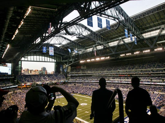 Spectators take pictures and watch the Lucas Oil Stadium roof open shortly before the start of the Indianapolis Colts' first exhibition game in the new stadium, against the Buffalo Bills, on Sunday, August 24, 2008. The Colts lost the game 20-7. (Charlie Nye / The Star).