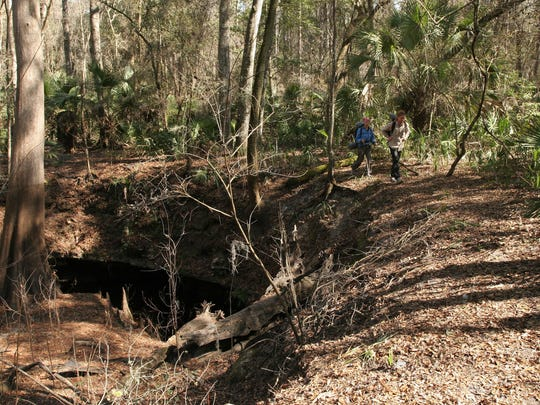 Backpackers Matt Keene and Jodi Eller hike the Florida Trail along the Aucila Sinks.