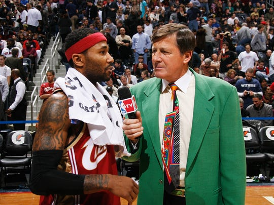 Craig Sager, broadcaster for NBA TV, interviews Mo Williams #2 of the Cleveland Cavaliers after a win against the Atlanta Hawks on December 29, 2009, at Philips Arena in Atlanta, Georgia.