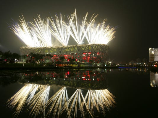 FILE - In this Aug. 8, 2008 file photo fireworks explode during the opening ceremony in the National Stadium at the Beijing 2008 Olympics in Beijing. The IOC said Friday July 22, 2016, that 45 more athletes — including 23 medalists — have been caught for doping in retesting of samples from the 2008 and 2012 Olympics. The new cases bring to 98 the number of athletes who have failed tests so far in the reanalysis of their stored samples form the Beijing and London Games. (AP Photo/Bullit Marquez, file)