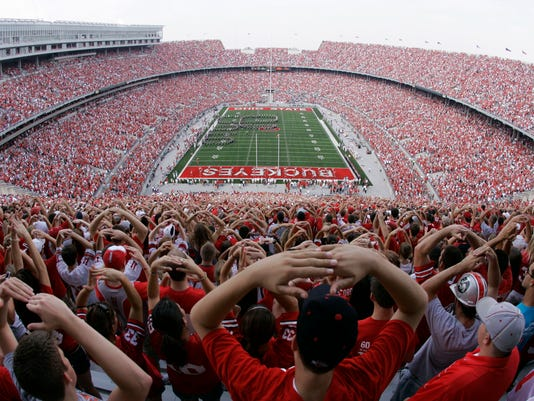 FILE - In this Sept. 22, 2007, file photo, Ohio State football fans get ready for Ohio Stadium's 500th football game, against Northwestern,  in Columbus, Ohio. The Associated Press has been ranking the best teams in college football for the last 80 seasons. (AP Photo/Kiichiro Sato, File)