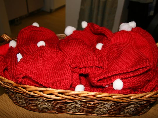 A basket of hats knitted by volunteers await distribution to babies born at SVMH.