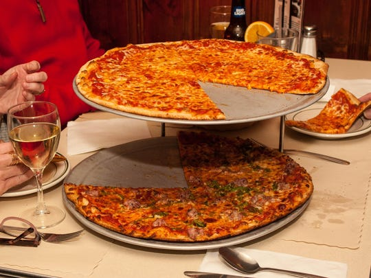 A pair of pizzas at Vic's Italian Restaurant, which