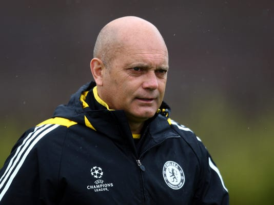 FILE - In this Monday, April 27, 2009 file photo, Chelsea assistant manager Ray Wilkins walks out to a training session at their training ground, Cobham, England. Former England captain Wilkins is in a critical condition in a hospital in London, it was reported on Saturday, March 31, 2018. St. George's University Hospital says the 61-year-old Wilkins is currently being treated there but did not disclose more details about his condition. (AP Photo/Tom Hevezi, File)