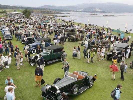 Historic automobiles fill the 18th fairw