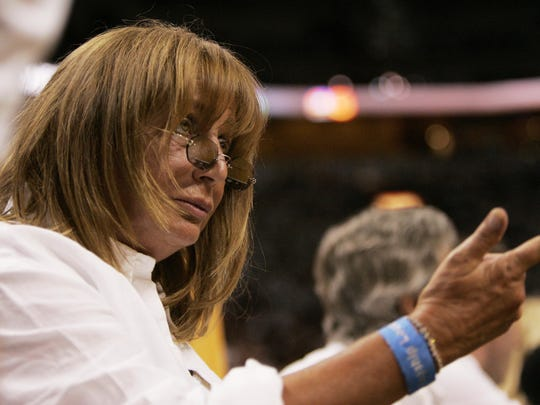 Penny Marshall has a cross-court conversation with Gary Payton on the bench during the first half as the Detroit Pistons take on the Miami Heat in Game 4 of the Eastern Conference Finals at American Airlines Arena in Miami, Florida on May 29, 2006.