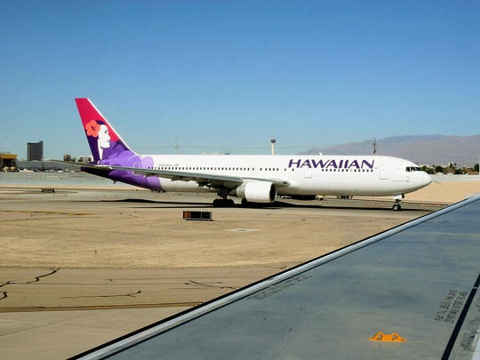 Officials say a Hawaiian Airlines flight from Honolulu to New York City was diverted to San Francisco after an attendant died of an apparent heart attack.