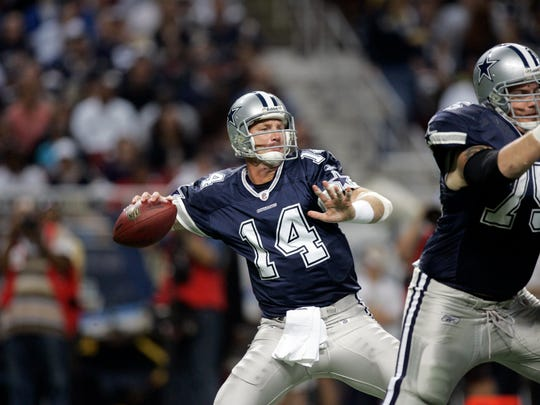 Dallas Cowboys quarterback Brad Johnson (14) throws the balls as teammate Marc Colombo blocks during the first quarter of an NFL football game against the St. Louis Rams Sunday, Oct. 19, 2008, in St. Louis. The Rams won the game, 34-14. (AP Photo/Jeff Roberson)