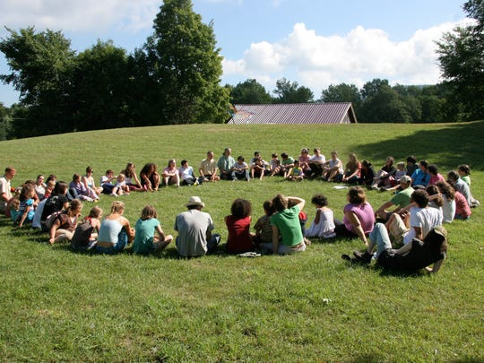 """The """"circle on the hill"""" takes place each day before lunch at Camp Common Ground and is a key community-building activity during which campers share announcements and anonymous notes of gratitude, and play team building games."""