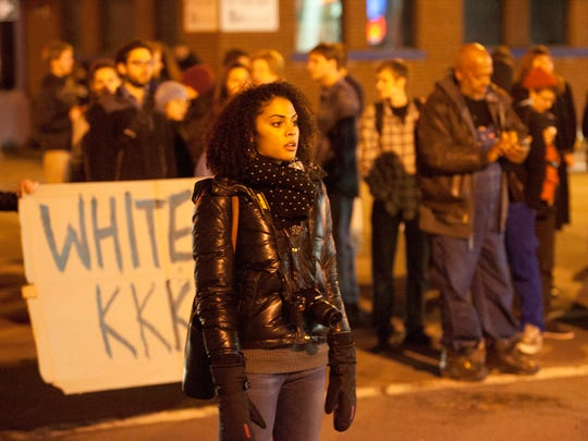 Protesters marched across downtown Ithaca Tuesday night, clogging portions of roads throughout the evening in protest of the Missouri grand jury's decision to not charge police officer Darren Wilson in the shooting death of Michael Brown.