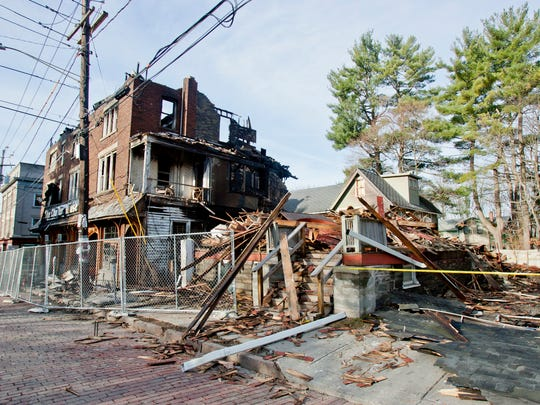 The apartment that stood at 406 Stewart Avenue was torn down Tuesday, deemed structurally unsafe and a total loss. There were five apartments in it.