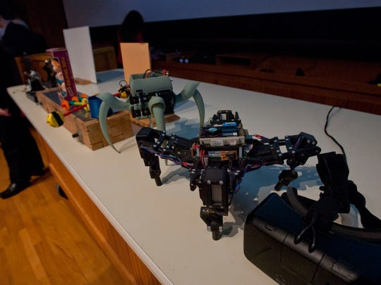 Robots are being built with 3-D printers and, like the black robot pictured, are beginning to teach themselves. The black robot learned how to recognize its shape and move itself over a period of time.