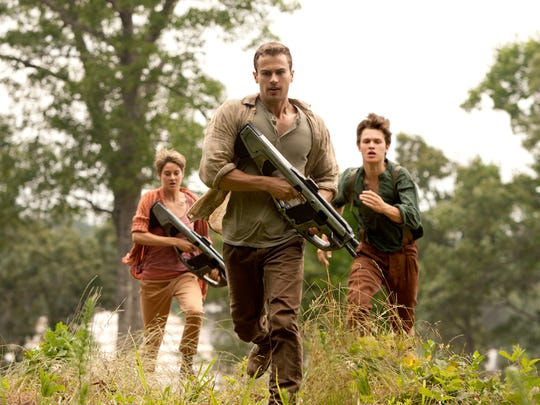 Theo James, center, Shailene Woodley and Ansel Elgort run for their lives in The Divergent Series: Insurgent.