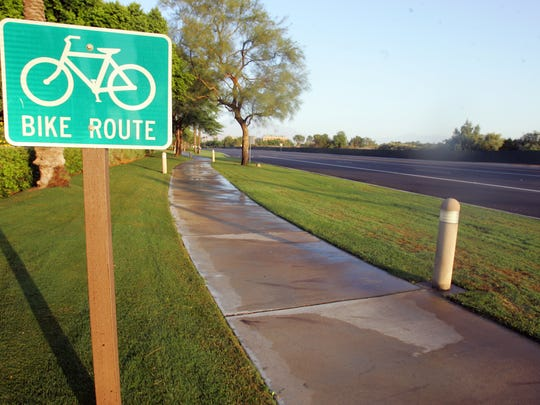 A sign marks a bicycle path which runs parallel to a bicycle lane along Highway 111 in Indian Wells at the Miles Ave./Manitou Dr. intersection on Tuesday morning, July 3, 2012. The proposed Whitewater Trail multi-use pathway will give Coachella Valley residents another area for recreational cycling that is off the roadway. Crystal Chatham, The Desert Sun