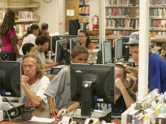 People visit the Desert Hot Springs Library in August 2012.