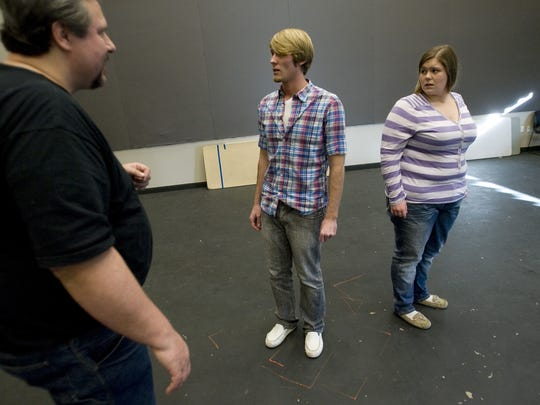 Varlo Davenport, left, works with Alex Gubler and Hannah Davenport, right, as they rehearse a scene from the Anton Chekov play called the Cherry Orchard in this file photo from when Davenport was teaching at Dixie State University.