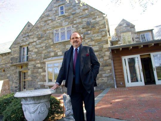 John Hynansky is seen in front of his former Greenville estate.
