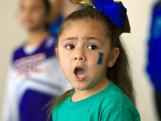 Kailyn Yeverino cheers with the help of the Texas A&M University-Corpus Christi cheerleaders during the 9th Annual Youth Clinic on Saturday, Jan. 28, 2017, at the American Bank Center in Corpus Christi.