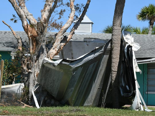 Part of the roof sits in front of a home on US 1 in South Brevard after Hurricane Irma. Brevard County reported more than 7,000 homes with damage, 400 of those with major damage.