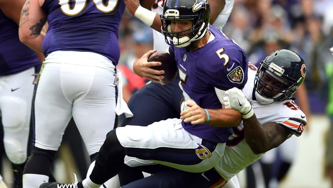 Baltimore Ravens quarterback Joe Flacco (5) is sacked by Chicago Bears inside linebacker Danny Trevathan in the first half of an NFL football game, Sunday, Oct. 15, 2017, in Baltimore.