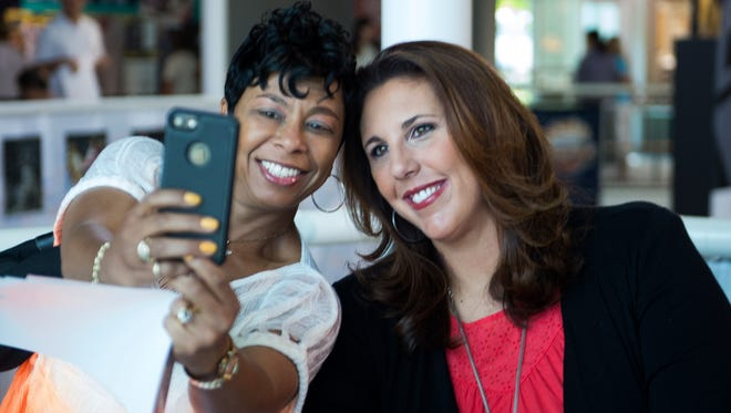 Margaret Mickey-Jones takes a selfie with 2017 inductee into the Women's Basketball Hall of Fame and Olympic gold medalist, Kara Wolters, at the Women's Basketball Hall of Fame in Knoxville, Tenn. on Saturday, June 10, 2017.