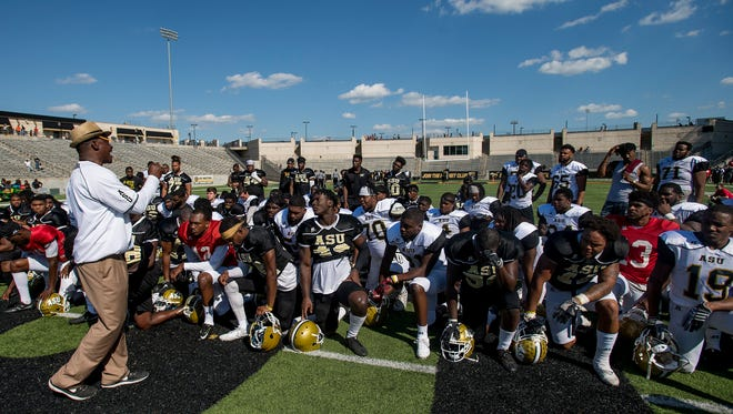 Head Coach Doanald Hill-Eley talks with players following the Alabama State University Black and Gold Game at Hornet Stadium on the ASU campus in Montgomery, Ala. on Saturday April 28, 2018.
