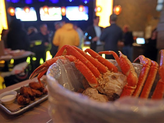King Crab legs with potatoes, and corn in a garlic butter sauce was a dish served during the grand opening of Holy Crab in White Plains.