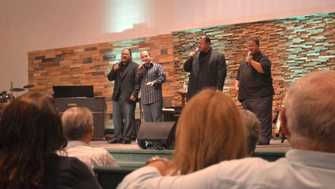 The Keepers of the Faith gospel quartet sings before a crowd of more than 200 at Woodland Church in Hobart on Aug. 23. The group includes three brothers Levi Taito Jr., on left; Ace, second from right; and Lima, on right, as well as Kevin Mills, second from left.
