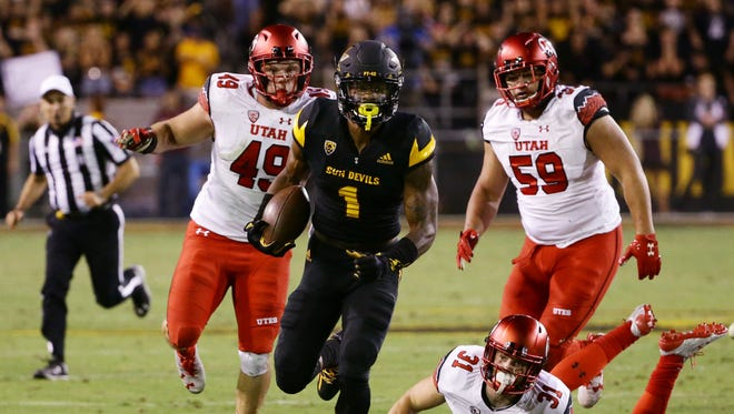 Arizona State wide receiver N'Keal Harry runs for a 31-yard touchdown against Utah in the 2nd quarter during PAC-12 action on Thursday, Nov. 10, 2016 in Tempe, Ariz.