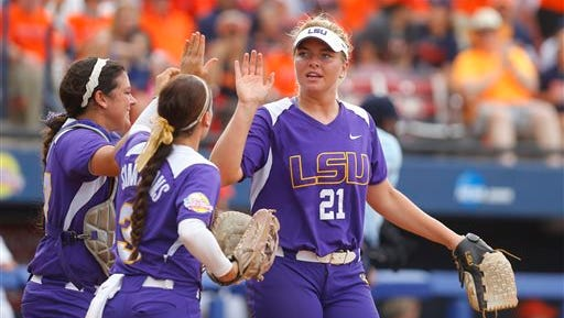 LSU's Carley Hoover (21) is congratulated by teammates Kellsi Kloss, left, and Sandra Simmons, center, after defeating Auburn in a game in the NCAA Women's College World Series softball tournament in Oklahoma City, Thursday.
