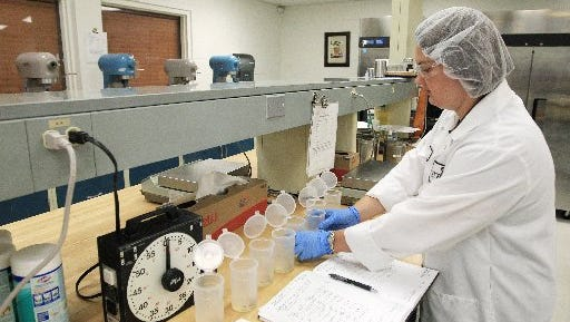 Kelsey Lindsay, scientist with Stratas Foods, works on creating cooking oil blends during stage one of product development at the company's research and development facility in Bartlett.