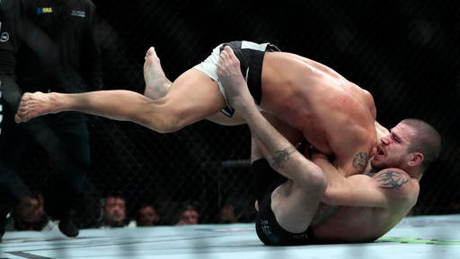 Thiago Alves, top, combats Jim Miller during a catchweight mixed martial arts bout at UFC 205, Saturday, Nov. 12, 2016, at Madison Square Garden in New York.